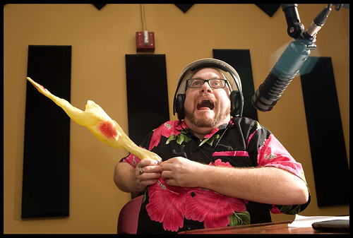 The rubber chicken strikes Andrew Ward while he's on air at WWOZ.  rhrphoto.com