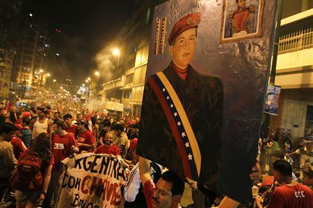 Supporters of President Hugo Chavez of Venezuela rally in the capital of Caracas. Chavez has won another term of office for six years. by Pan-African News Wire File Photos