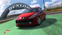 executive car(0.0), sedan(0.0), race car(1.0), automobile(1.0), automotive exterior(1.0), peugeot(1.0), peugeot 308(1.0), family car(1.0), wheel(1.0), vehicle(1.0), automotive design(1.0), subcompact car(1.0), city car(1.0), bumper(1.0), land vehicle(1.0), luxury vehicle(1.0),