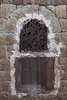Yemeni traditional ornate window in al hajjarah, yemen by anthony pappone photographer