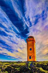 Lighthouse and Big Sky