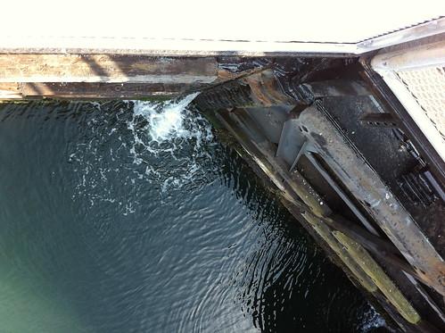 Water leaving as the locks doors swing shut