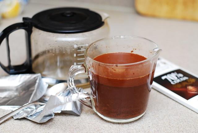 adding chocolate to hot coffee
