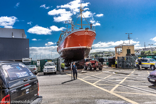 Trawler Being Lifted From Howth Harbour And Then Transported To The Boat Yard For Maintenance by infomatique