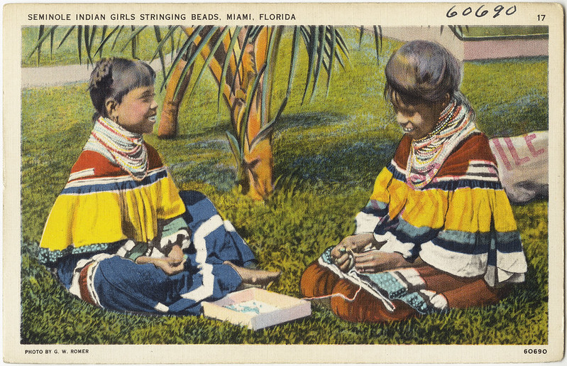 Seminole Indian girls stringing beads, Miami, Florida