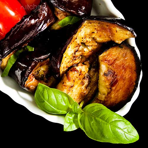 Roast Eggplant in Dish with Grape Tomatoes and Basil, Overhead View