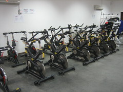 chest(0.0), sport venue(0.0), muscle(0.0), leg extension(0.0), room(1.0), indoor cycling(1.0), gym(1.0),