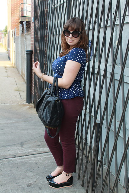 "Dark tones outfit: Plum colored ""Stevie"" jeans by AG, navy peplum top with white polkadots, black patent leather Jeffrey Campbell flatforms, etc."