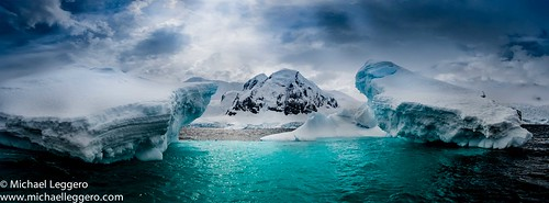 ocean blue sea sky moon snow ice nature water clouds landscape island scenic floating antarctica half iceberg iceburg