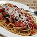 No-cook fresh tomato pasta sauce with kalamata olives, capers, and basil