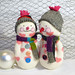 A pair of Sock Snowmen with hearts