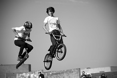 mountain bike(0.0), freeride(0.0), bicycle motocross(1.0), white(1.0), vehicle(1.0), bmx bike(1.0), sports(1.0), flatland bmx(1.0), sports equipment(1.0), cycle sport(1.0), monochrome photography(1.0), extreme sport(1.0), bmx racing(1.0), stunt performer(1.0), monochrome(1.0), black-and-white(1.0), black(1.0), bicycle(1.0),