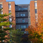 tour-0023 -- Ferguson and Munsell residential halls feature single- and double-occupancy student rooms, with kitchens and lounges on each floor. The Halls connect to the Memorial Center by an indoor walkway.