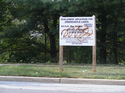 Vandalized 'New Fence' Sign