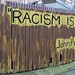Small photo of RACISM IS...