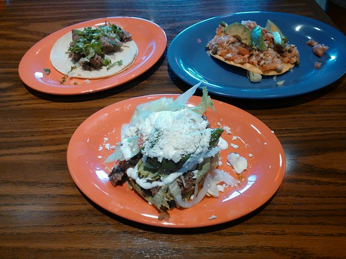 Clockwise from front: Barbacoa Sope, Lengua Taco, and Shrimp Ceviche Tostada