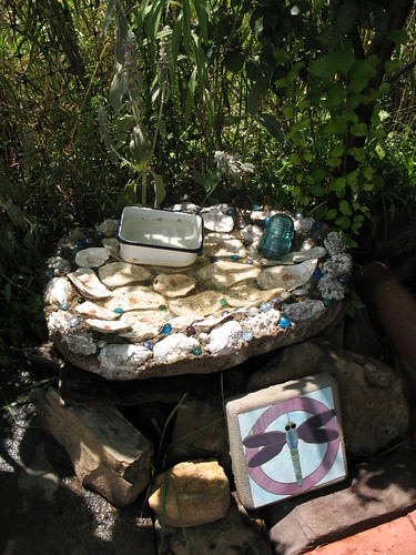 bird bath - oyster shells, insulator, glass, and enamel