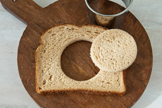 cutting hole in toast with a biscuit cutter