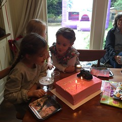 girls blowing out their candles