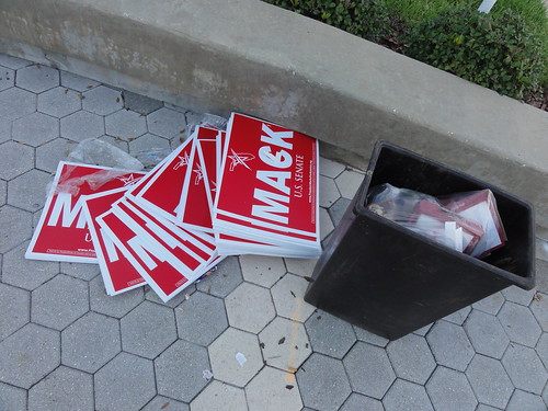Pile of Cornelius Harvey McGillicuddy IV signs next to trash