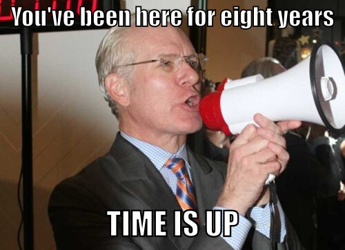 Tim Gunn yelling into a megaphone. Text reads, You've been here 8 years. Time is up.
