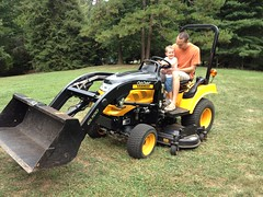 agricultural machinery(0.0), all-terrain vehicle(0.0), riding mower(1.0), vehicle(1.0), lawn(1.0), land vehicle(1.0), tractor(1.0),