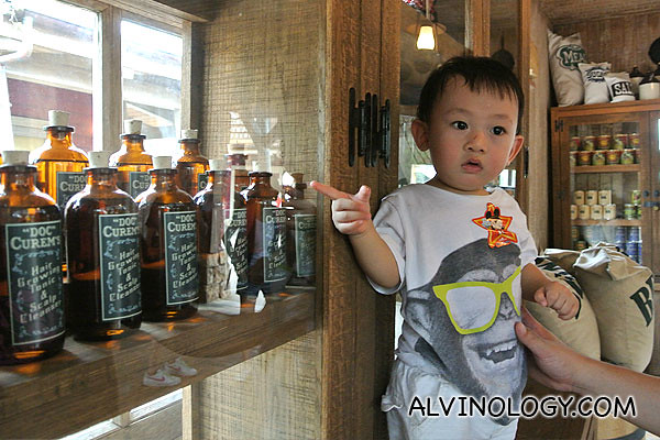 Asher pointing at some items on the shelves