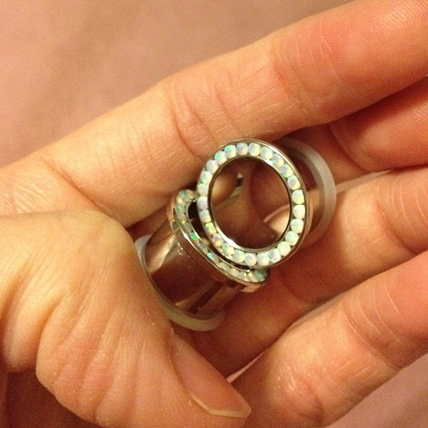 the customary fourth anniversary gift: bling tunnels.