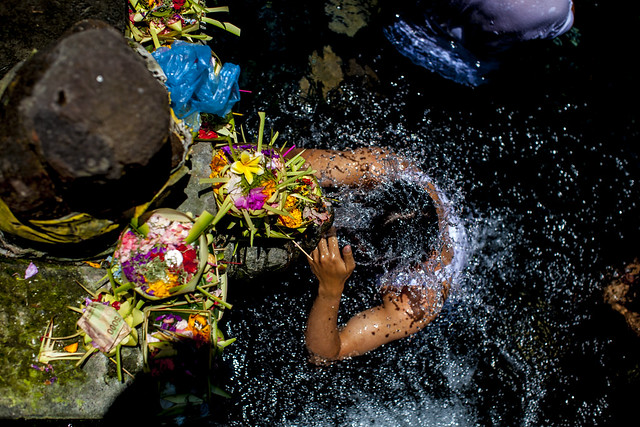 Man at purification fountain in Bali