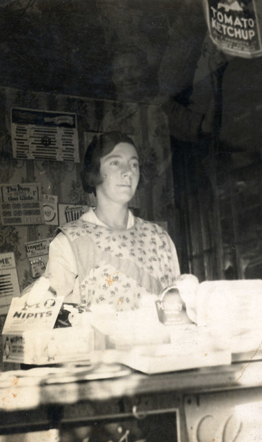 Woman in a grocer's shop
