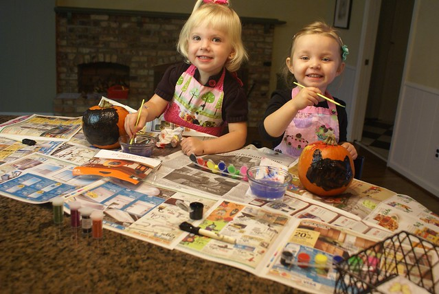 Elsa and Lilah painting pumpkins