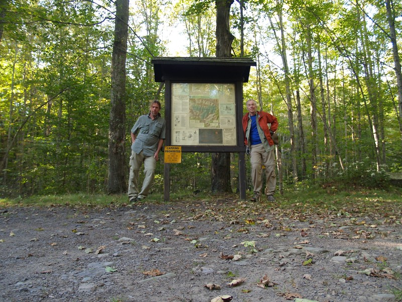 Tired but Satisfied Hikers at the Spruceton Trail Trailhead Information Kiosk