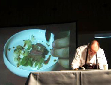 Dutch Chef Eric Troost prepares an upscale dish using U.S. beef during a cooking demonstration for about 130 Belgian chefs Sept. 24. The demo was part of the first U.S. beef tasting event held in Belgium, which was hosted by the Foreign Agricultural Service (FAS) office in The Hague, Netherlands, and the U.S. Meat Export Federation (USMEF). The tasting was part of ongoing efforts to help expand U.S. beef exports to the European Union (EU). (Photo courtesy FAS The Hague)