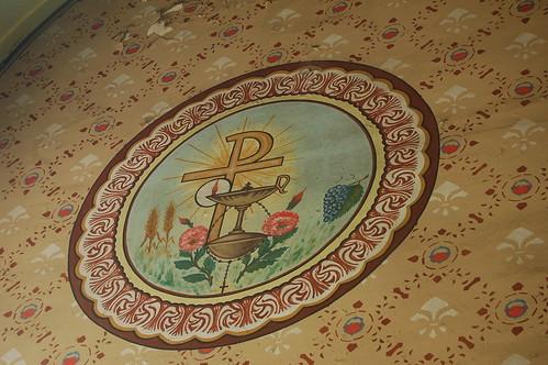 Das Wappen zeigt eine heilige Öllampe