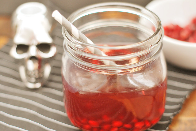 Bloody Tooth Cocktail - the creepiest cocktail for your Halloween party! Pomegranate juice and whiskey with pomegranate arils to look like bloody teeth!