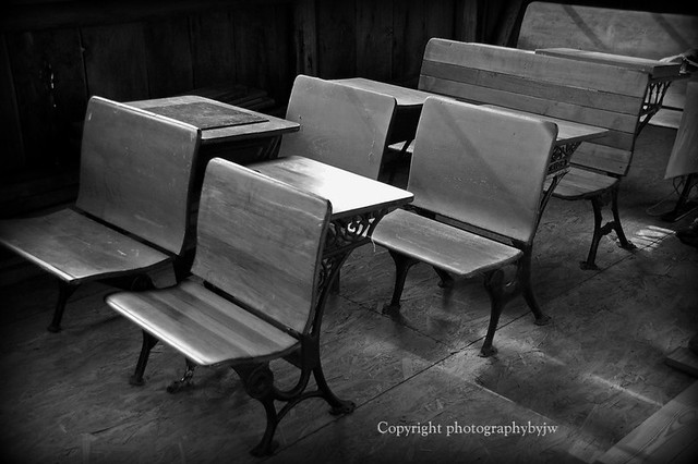vintage school desks in a row by jwhanley