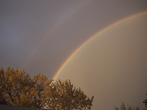 Double rainbow behind our house!
