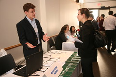 Image of a recruiter talking with a Brandeis IBS student at a career fair