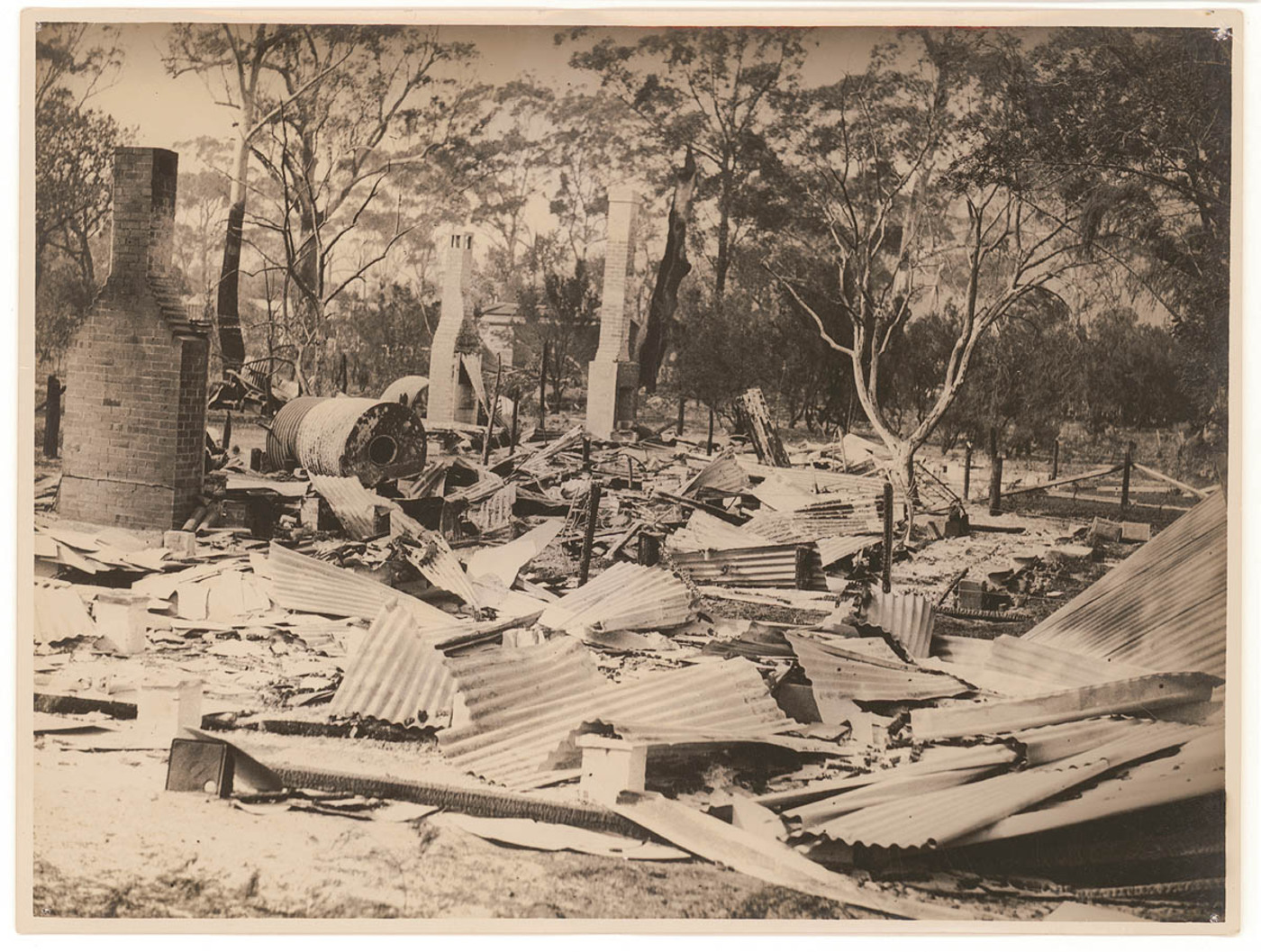 House destroyed by bushfire, New South Wales, late 1920's / photographer Sam Hood