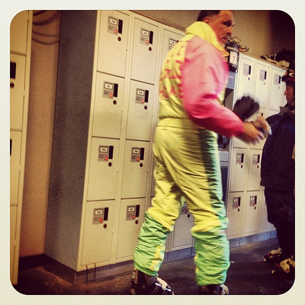 "Retro ski fashion-- a full neon jumpsuit with ""Free to good home"" taped on back"