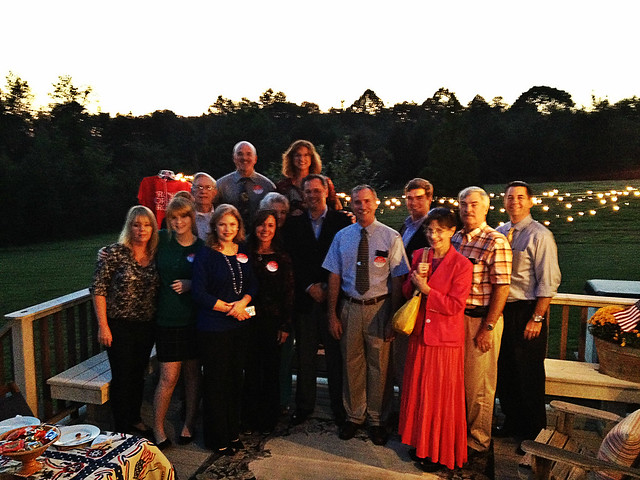 Group photo of the attendees at the reception in Burlington.