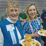 12-073 -- Judy Rickard '62 and Zoe Gross '13 were among members of the senior class and the 50th anniversary class of 1962 who paired off for lunch at the Alumni Awards Luncheon.