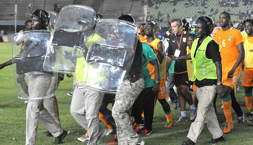Football players from Ivory Coast seen being escorted off the field in Senegal. The Senegal club is being held responsible for the outbreak of violence in Dakar. by Pan-African News Wire File Photos