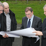 Minister announces funding for North West Regional Sports Campus. Showing the Minister the plans from Derry City Council are l to r: Frank Morrison, Barry O