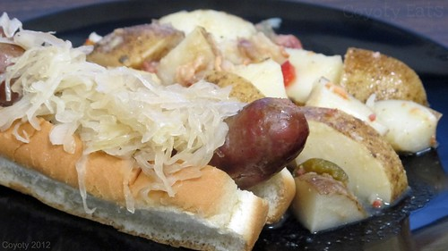 Bratwurst with sauerkraut and German potato salad by Coyoty