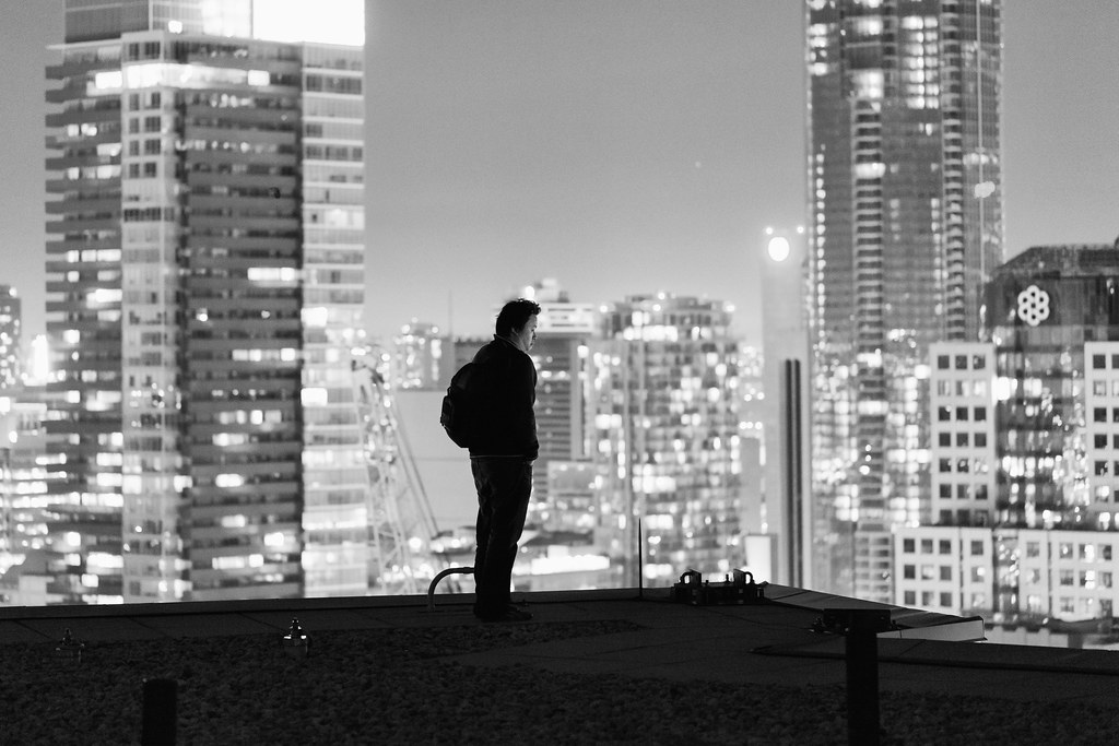 black and white portrait of ronnie yip on a rooftop in toronto