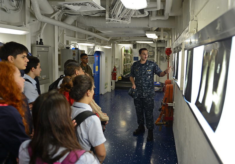 Ensign Alexander Petit talks to high school students about the medical facility aboard USS Bonhomme Richard.