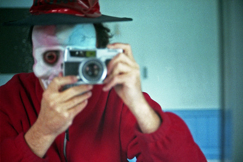 reflected self-portrait with Petri 7s camera and halloween mask by pho-Tony