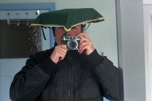 reflected self-portrait with Diax 1a camera and green four cornered hat by pho-Tony