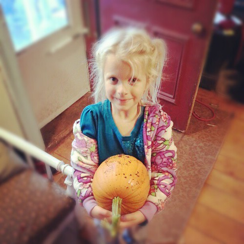 Oh so very proud of her self grown pie pumpkin.